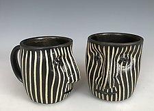 Vertical Lines Face Mug by Larry Halvorsen (Ceramic Mug)