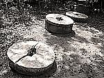 Grinding Stones - Three by Joni Purk (Black & White Photograph)