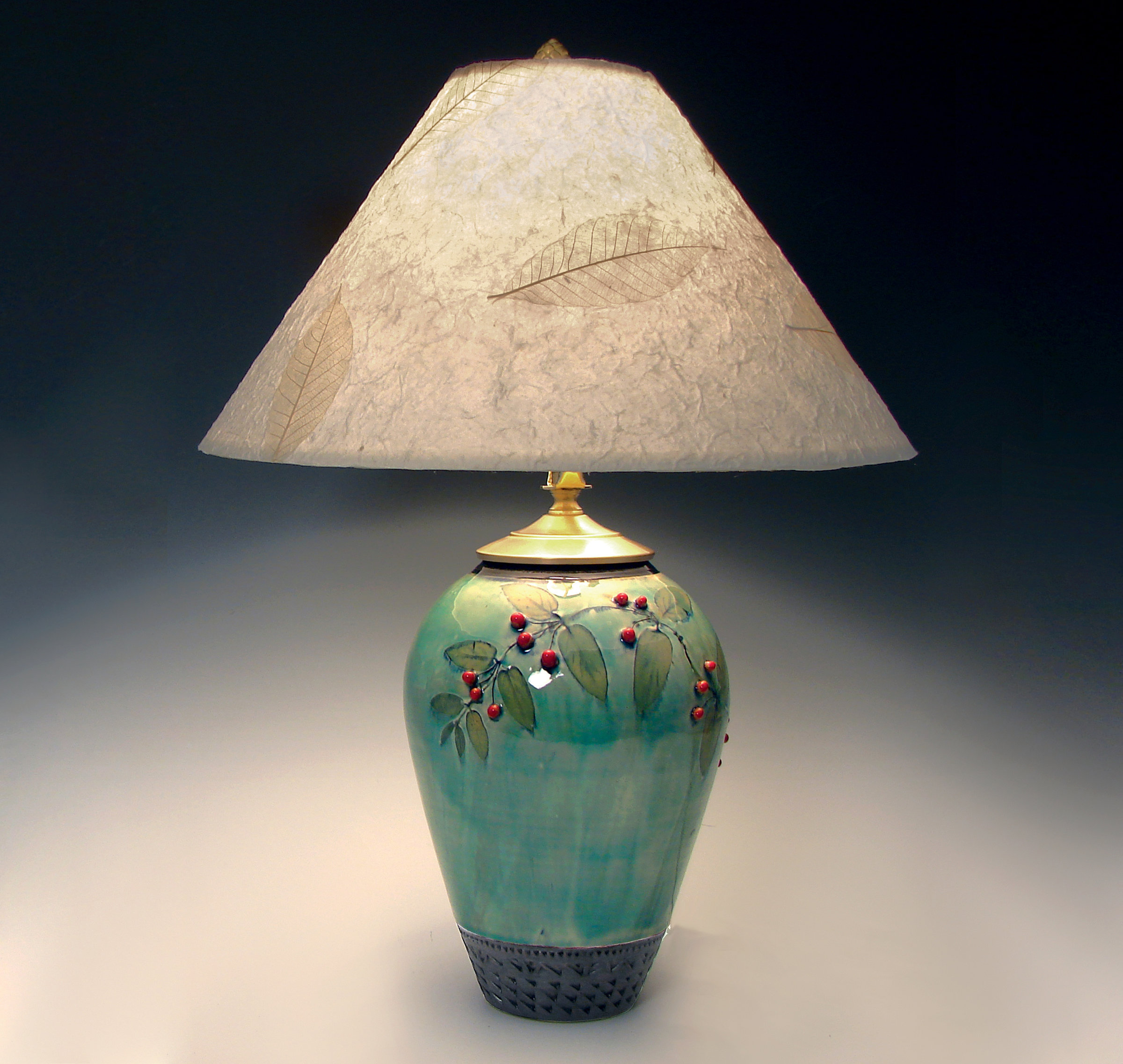 Small celadon lamp with red berries by suzanne crane for Ceramic table lamps