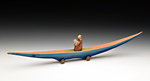 Journey Boat: Figure with Infant by Dona Dalton (Wood Sculpture)