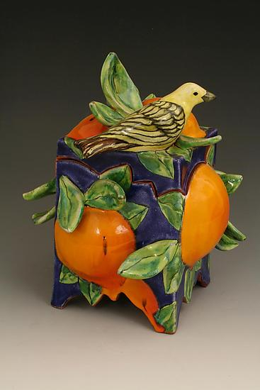 Dark Blue Box with Oranges and Yellow Bird