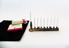Travel Menorah by Mary Ann Owen and Malcolm  Owen (Metal Menorah)