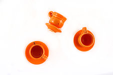 Tangerine Teacups on the Wall by Carol Tripp Martens (Ceramic Wall Sculpture)