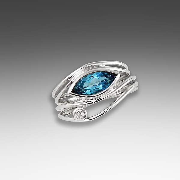 Silver and Blue Topaz East West Ring