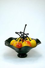 Black Fluted Bowl of Rainier Cherries by Donald  Carlson (Art Glass Sculpture)