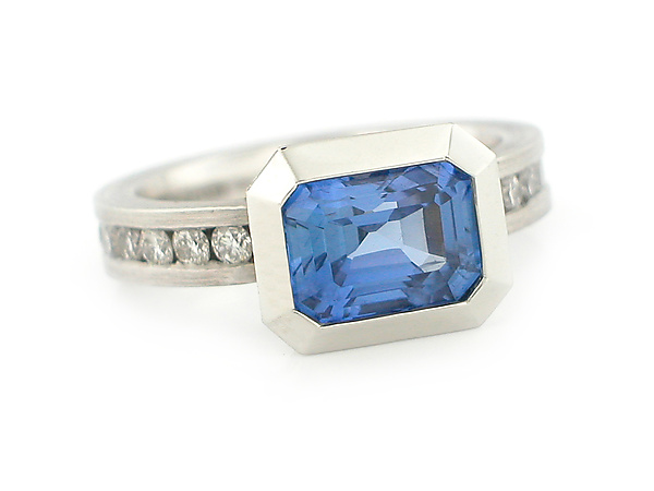 Oblique Ring in 950 Pt. with Blue Sapphire and Diamonds