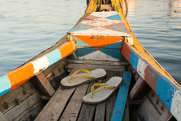 Sandals at Sea in a Multicolored Boat