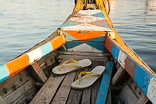 Sandals at Sea in a Multicolored Boat by Cindy A. Stephens (Color Photograph)