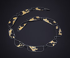 What is Past by Marcia Meyers (Gold & Silver Necklace)