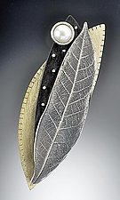 Silver Chinkapin Leaf pin with Studded Ebony, Pearl, and Brass by Suzanne Linquist (Mixed-Media Brooch)