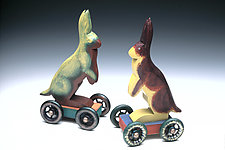 Fancy Wheel Rabbits by Dona Dalton (Wood Sculpture)