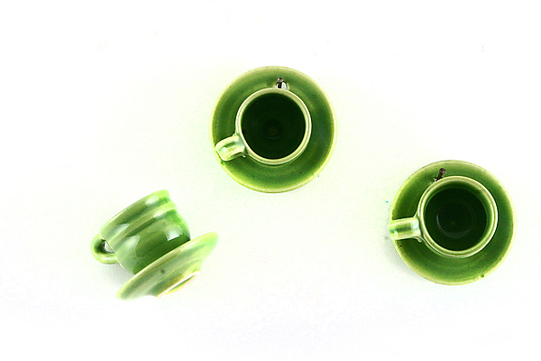 Green Teacups on the Wall