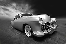Oozing Down the Street - Siver Cadillac by Jim Bremer (Black & White Photograph)