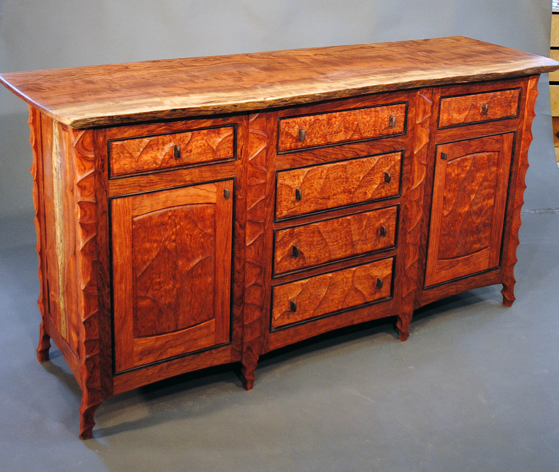 Sculpted bubinga sideboard with live edge top by john